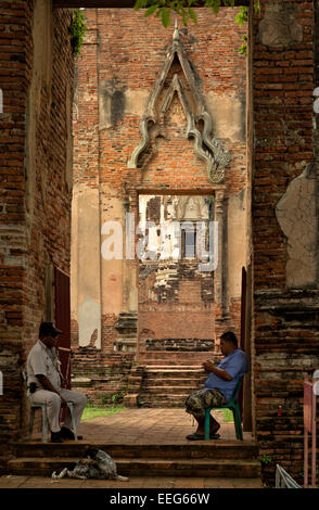 TH00320-00...THAILAND - Guard and maintenance worker at entrance to Wat Ratcha Burama in the Ayutthaya Historical - Stock Photo