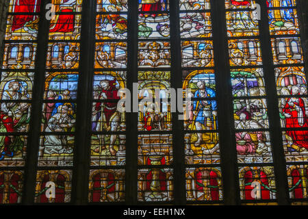Stained glass window in cathedral of Notre Dame de Tournai - Stock Photo