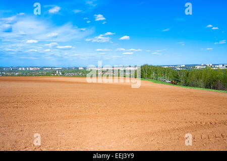 The agricultural arable land field in the spring for crops - Stock Photo
