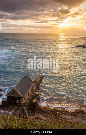 Dramtic sunset over Polpeor Cove at Lizard Point Cornwall England UK Europe - Stock Photo