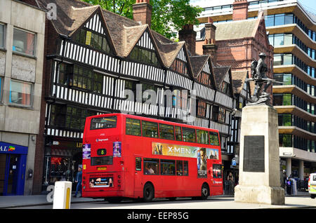 A Red Double Decker Bus on High Holborn Outside Staple Inn, London, England, UK - Stock Photo