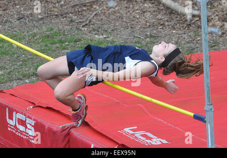 Female High school high jumper in action CT USA - Stock Photo
