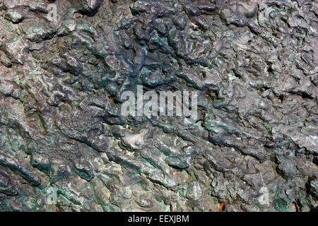 The frozen rusty oxidize drops of the melted metal abstract backgound - Stock Photo