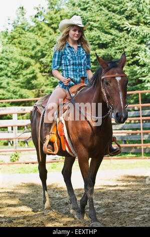 Woman riding a horse outdoors - Stock Photo