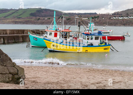 Two fishing boats moored in Newquay Harbour in Ceredigion on the West Coast of Wales.  Newquay is a small fishing - Stock Photo