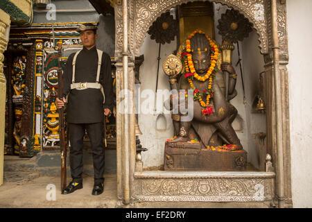 Solider and God - Kathmandu Durbar Square Palace, Nepal. - Stock Photo