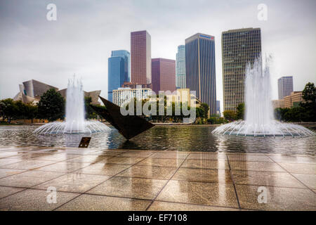 Los Angeles city center with reflecting pool in the foreground - Stock Photo