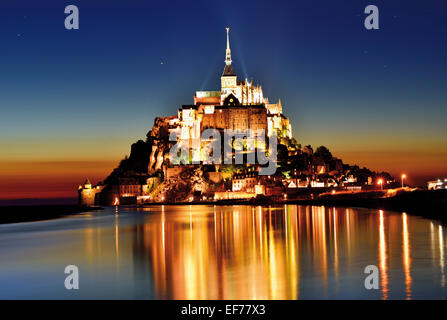 France, Normandy: Scenic view of Le Mont St. Michel by night - Stock Photo