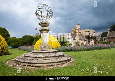 A contemporary piece of sculptural artwork and Rockingham Castle set against a stormy summer sky, near Corby in - Stock Photo