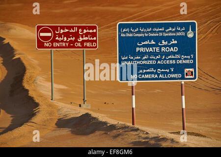 Warning signs beside road, Liwa sand dunes, Abu Dhabi, United Arab Emirates - Stock Photo