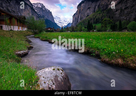 Switzerland, Jungfrau Region, Lauterbrunnen Valley, Sunrise among mountains - Stock Photo