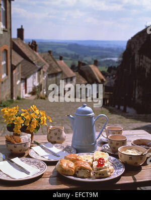Afternoon cream tea on table at top of Gold Hill, Shaftesbury, Dorset, England, United Kingdom - Stock Photo