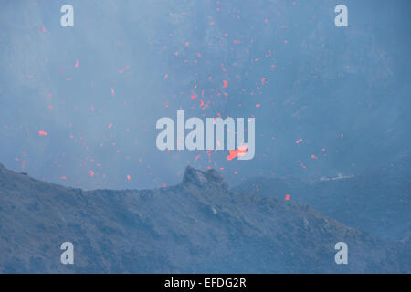 Melanesia, Vanuatu, Tanna Island. Mt. Yasur volcano. Crater overlook, view into steaming active volcano with molten - Stock Photo