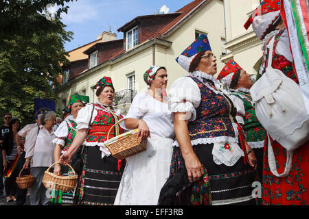 Women in traditional costumes with baskets of grapes at the International Wine festival at Castle Hill, Budapest, - Stock Photo