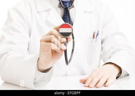 Doctor holding stethoscope with flag series - Yemen - Stock Photo