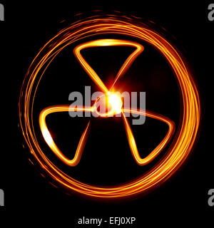 Radiation sign created by light - Stock Photo