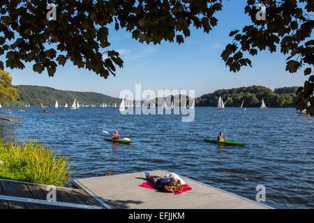 People enjoying summer, on a jetty, 'Baldeneysee' lake, river Ruhr, Essen, Germany, - Stock Photo