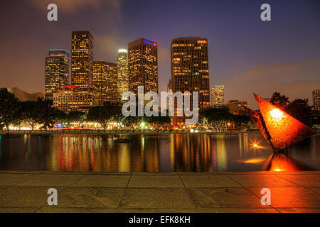 Los Angeles city center with reflecting pool in the foreground at night - Stock Photo