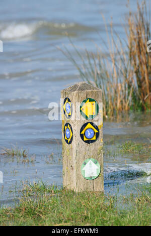High tide floods the marked footpath on the Isle of Anglesey Coastal Path at Red Wharf Bay (Traeth-coch) / Anglesey - Stock Photo