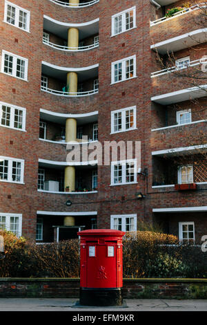British Red Pillar Post Box in front of Flats in Belgravia London - Stock Photo