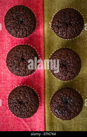 Mini chocolate brownie cupcakes on colorful background - Stock Photo