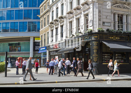 City workers drinking outside the Globe pub at the junction of Moorgate and London Wall - Stock Photo