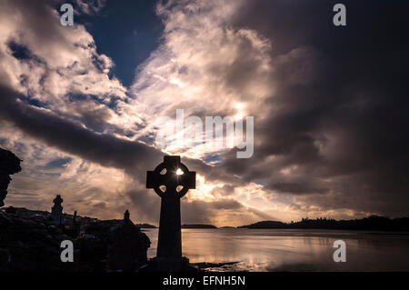 Dramatic light at sunset by Old Abbey Cemetery and Donegal Bay in Donegal Town County Donegal Ireland - Stock Photo