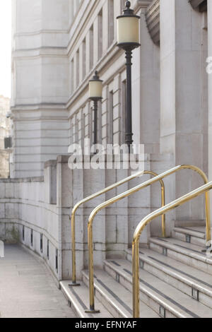 Gold Hand Rails for steps on a office building in London - Stock Photo