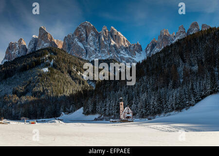 Winter view of St Johann in Ranui church with Puez-Geisler Dolomites, Villnoss Val di Funes, Alto Adige South Tyrol, - Stock Photo