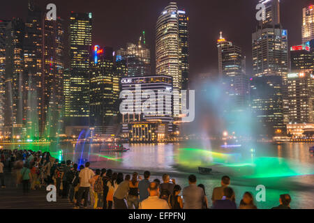 Lightshow in front of downtown central financial district at night, Singapore, Southeast Asia, Asia - Stock Photo