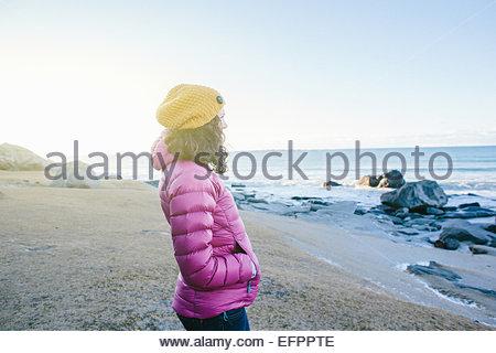 Woman enjoying beach, Lofoten, Norway - Stock Photo