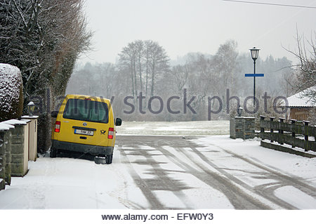 Snowy winter Snow covered cold Rural winter time icy freezing cold weather Munich German Bavaria Germany DE Deutchland - Stock Photo