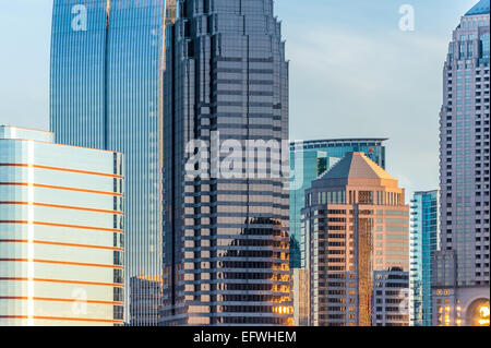 Sunset lights the glass monoliths of the Midtown Atlanta skyline. - Stock Photo