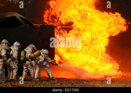 Firefighters from the Ohio Air National Guard's 180th Fighter Wing extinguish an aircraft fire during a training - Stock Photo
