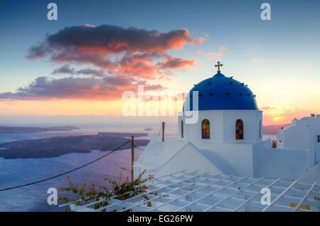 Sunset over Imerovigli, Santorini, Cyclades, Greece - Stock Photo