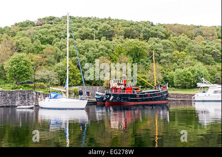 Restored puffer VIC32 moored in the canal basin in Crinan Argyll & Bute Scotland - Stock Photo