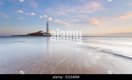 Sunrise on New Year's Day morning at St Mary's Lighthouse in Whitley Bay, on the North East Coast of England. - Stock Photo