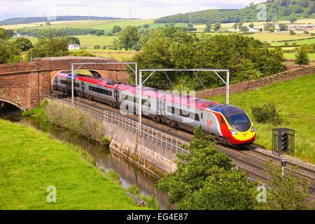 Class 390 Pendolino Virgin train train. Kitchenhill Penrith West Coast Main Line Cumbria England UK - Stock Photo
