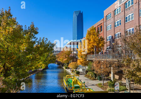 The Bricktown canal, looking towards the Devon Tower, in the historic Bricktown district of Oklahoma City, OK, USA - Stock Photo