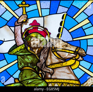 Stained glass window in church depicting Santiago Apostol (Saint James) the moor slayer. - Stock Photo
