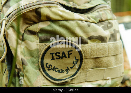 Bangor, Northern Ireland. 18 Feb 2015 - ISAF badge on the bergen of a British soldier Credit:  Stephen Barnes/Alamy - Stock Photo
