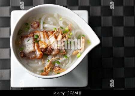 Thai Noodle Soup with Crispy Pork - Stock Photo