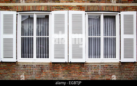 Windows with white shutters, Germany - Stock Photo