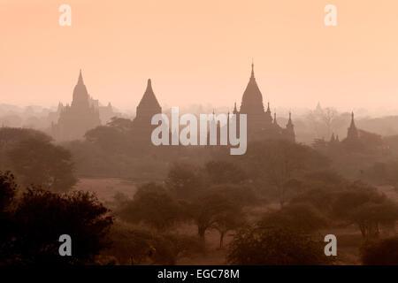 Bagan temples in the early morning mist at sunrise, Bagan Plain, Myanmar, ( Burma ), Asia - Stock Photo