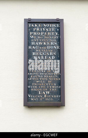 Very old metal sign on the gable end of a row of terrace houses. - Stock Photo