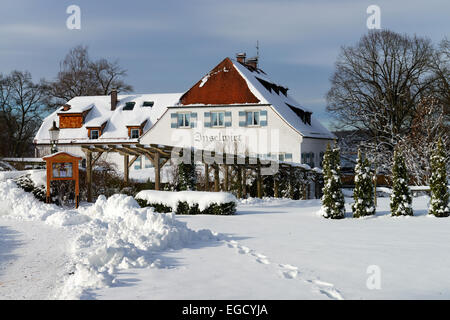 The Inselwirt Hotel and Guesthouse in winter, island Frauenchiemsee, also called Fraueninsel, Chiemsee lake, Chiemgau - Stock Photo