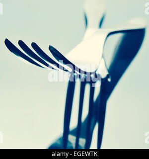 closeup of some forks on a reflecting surface, with a filter effect - Stock Photo