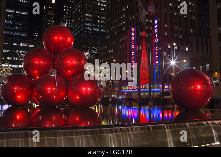 GIANT BALL CHRISTMAS ORNAMENTS RADIO CITY MUSIC HALL AVENUE OF THE AMERICAS NEW YORK CITY USA - Stock Photo