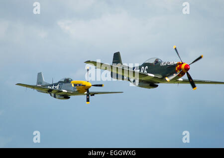Two P-51D Mustangs, nicknamed Old Crow and Ferocious Frankie in United States Army Air Corps colors during a low - Stock Photo