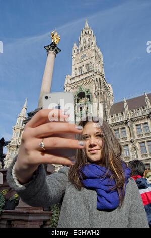 Selfie, girls (14 years old), Marienplatz, Marian column on the Marienplatz, New Town Hall, MunicUpper Bavaria, - Stock Photo